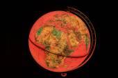 Terrestrial globe på svart bakgrund — Stockfoto