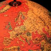 Terrestrial globe on black background — Stock Photo