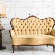 Brown sofa with lamp — Stock Photo #76752721