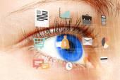 Woman blue eye looking at digital virtual screen — Foto Stock