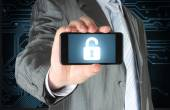 Businessman holds smart phone with open lock — Stockfoto