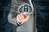 Businessman pushing virtual cloud security button — Stock Photo