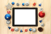 Tablet PC with Christmas decorations — Stockfoto