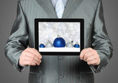 Man holds tablet PC with Christmas composition — Stockfoto