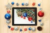 Tablet PC with Christmas decorations — Stock Photo