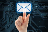 Hand pushing virtual mail button — Stock Photo