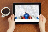 Hands hold tablet PC with Christmas composition — Stock Photo