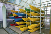Array of color canoes — Stock Photo