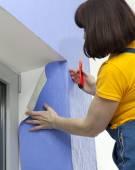 Woman doing repairs — Stock Photo