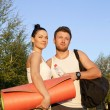 Woman and man in sports clothes — Stock Photo #61531969