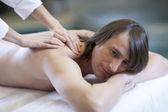 Man receiving massage relax treatment close-up from female hands — Foto de Stock
