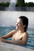 Woman relaxing in the water — Stock Photo