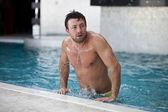 Man posing in the swimming pool — Stock Photo