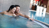Couple relaxing in jacuzzi — Stock Photo