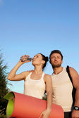 Woman and man in sports clothes — Stock Photo