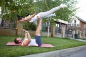 Man and woman performing acrobatics — Stock Photo