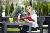 Woman at a table in a cafe — Stock Photo