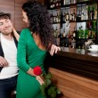 Man with a flower in a hand and the fine girl in cafe — Stock Photo #64490215