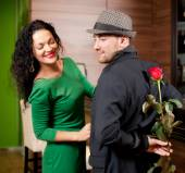 Man with a flower in a hand and the fine girl in cafe — Stock fotografie