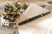 Christmas cone with gifts,pen and letter greetings holiday concept — Stock Photo