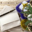 Christmas tree with gifts,pen and letter greetings holiday concept — Stock Photo #58790989