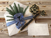 Christmas branch tree with gifts,pen and letter greetings card holiday concept — Stock Photo