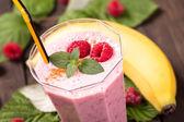 Raspberry banana smoothie closeup — Stock Photo