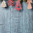 Vintage christmas decorations on old wooden background — Stock Photo #57213599