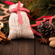 Gift bag and other christmas decorations — Stock Photo #57557679