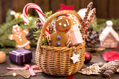 Basket of various Christmas treats, gingerbread man on the table — Stock Photo