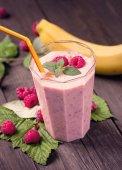 Banana raspberry smoothie on table — Stock Photo