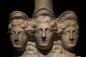 Three headed roman-asian ancient statue of beautiful women — Stock Photo