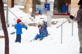 Father and sons playing snowballs in Jerusalem — Stock Photo