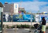 Roadside billboard next to light train station in Jerusalem — Stock Photo