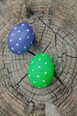 Two Easter eggs on a stump — Stock Photo