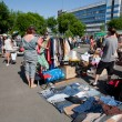 Looking for second hand jeans and used items on the open air flea market — Stock Photo #53292727