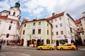 Old city with historical buildings and taxi cars — Stock Photo