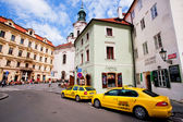 Taxi cabs waiting for the tourists in historical center of Czech capital — Stock Photo