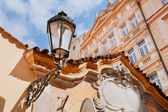 Old buildings and street lamp on the wall — Stock Photo