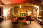 Old fashion design room with brick walls and vintage furniture at underground of the historical building — Stock Photo