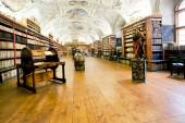 Plurality of stacks of books in ancient library — Stock Photo