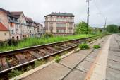 Old city railway near the historical buildings of the town — Stock Photo