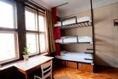 Three-level dormitory beds inside the hostel room for six tourists or the students — Stock Photo