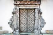Old metal doors of white building — 图库照片