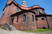 Red brick walls of the old catholic church — Stock Photo