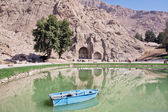 Lake of mountains with ancient Arches of Taq-e Bostan. — Stock Photo