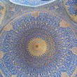 Patterns under the dome of the ancient Iranian mosque with blue color mosaic and tiles — Stock Photo #67151341