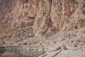 Mountain lake in beautiful persian valley with historical rocky reliefs — Stock Photo
