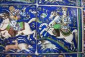 Riders on horseback on the vintage ceramic tiles — Stock Photo