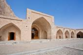 Ancient caravanserai in the mountains under the blue sky — Stock Photo